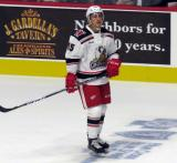 Dominik Shine of the Grand Rapids Griffins stands near the boards during pre-game warmups before his team's season-opening game against the Manitoba Moose.