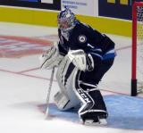 Eric Comrie of the Manitoba Moose gets set in his crease during pre-game warmups before his team's season-opening game against the Grand Rapids Griffins.