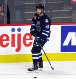 Kyle Connor of the Manitoba Moose skates near the boards during pre-game warmups before his team's season-opening game against the Grand Rapids Griffins.