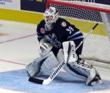 Michael Hutchinson of the Manitoba Moose gets set in his crease during pre-game warmups before his team's season-opening game against the Grand Rapids Griffins.