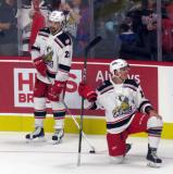 Axel Holmstrom and Dan Renouf of the Grand Rapids Griffins stand near the boards during pre-game warmups before their team's season-opening game against the Manitoba Moose.
