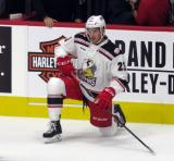 Dominic Turgeon of the Grand Rapids Griffins stretches near the bench during pre-game warmups before his team's season-opening game against the Manitoba Moose.