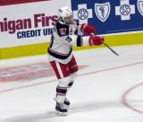 Matt Ford of the Grand Rapids Griffins fires a puck up ice during pre-game warmups before his team's season-opening game against the Manitoba Moose.