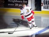 Joe Hicketts of the Grand Rapids Griffins skates to the blue line during player introductions at the start of his team's home opener against the Manitoba Moose.