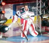 Jared Coreau of the Grand Rapids Griffins skates to the blue line during player introductions at the start of his team's home opener against the Manitoba Moose.
