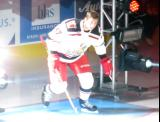 Corey Elkins of the Grand Rapids Griffins skates to the blue line during player introductions at the start of his team's home opener against the Manitoba Moose.