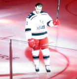 Dylan McIlrath of the Grand Rapids Griffins skates to the blue line during player introductions at the start of his team's home opener against the Manitoba Moose.