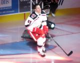 Dominik Shine of the Grand Rapids Griffins skates to the blue line during player introductions at the start of his team's home opener against the Manitoba Moose.