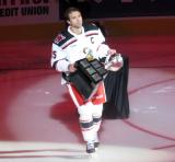 Matt Ford of the Grand Rapids Griffins skates with the Calder Cup as part of the team's banner-raising ceremony before their home opener against the Manitoba Moose.