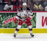 Matt Ford of the Grand Rapids Griffins skates near the boards during his team's home opener against the Manitoba Moose.
