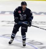 Kyle Connor of the Manitoba Moose skates near center ice during his team's season-opening game against the Grand Rapids Griffins.