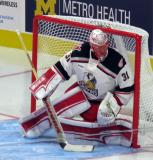 Jared Coreau of the Grand Rapids Griffins slides over to cover the post during his team's home opener against the Manitoba Moose.