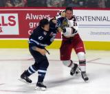 Kale Kessy of the Manitoba Moose and Dan Renouf of the Grand Rapids Griffins grapple with each other during the Griffins' home opener.