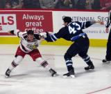 Dan Renouf of the Grand Rapids Griffins and Kale Kessy of the Manitoba Moose continue throwing punches at each other in a fight during the Griffins' home opener.