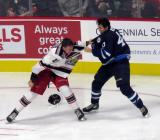 A fight between Dan Renouf of the Grand Rapids Griffins and Kale Kessy of the Manitoba Moose winds down during the Griffins' home opener.
