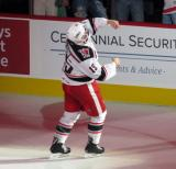Turner Elson of the Grand Rapids Griffins throws a t-shirt into the stands as the first star of a win over the Manitoba Moose.