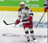 Dominik Shine of the Grand Rapids Griffins skates during pre-game warmups before a game against the San Antonio Rampage.