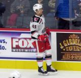 Colin Campbell of the Grand Rapids Griffins skates near the boards during pre-game warmups before a game against the San Antonio Rampage.