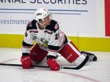 Dan Renouf of the Grand Rapids Griffins stretches near the boards during pre-game warmups before a game against the San Antonio Rampage.