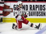 Matt Puempel of the Grand Rapids Griffins stretches near the boards during pre-game warmups before a game against the San Antonio Rampage.