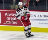 Matt Puempel of the Grand Rapids Griffins skates near the boards during pre-game warmups before a game against the San Antonio Rampage.