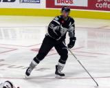 Chris Butler of the San Antonio Rampage skates through a faceoff circle during a game against the Grand Rapids Griffins.