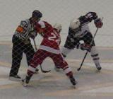 Chris Chelios takes a faceoff during the Pro-Am Skate for Mott game.