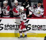Matt Lorito of the Grand Rapids Griffins skates along the bench after a goal during a game against the San Antonio Rampage, high fiving Jared Coreau, Evgeny Svechnikov, and Turner Elson.