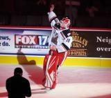 Tom McCollum of the Grand Rapids Griffins waves to the crowd after being introduced as the third star of a game against the San Antonio Rampage.