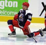 Ben Street of the Grand Rapids Griffins stretches during pre-game warmups before the team's annual Purple Game.
