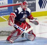 Tom McCollum of the Grand Rapids Griffins gets set in his crease during pre-game warmups before the team's annual Purple Game.