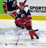 Vili Saarijarvi of the Grand Rapids Griffins skates with a puck during pre-game warmups before the team's annual Purple Game.