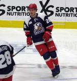 Dan Renouf of the Grand Rapids Griffins skates in the neutral zone during pre-game warmups before the team's annual Purple Game.
