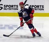 Dylan McIlrath of the Grand Rapids Griffins skates during pre-game warmups before the team's annual Purple Game.