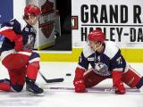 Joe Hicketts and Matt Puempel of the Grand Rapids Griffins stretch during pre-game warmups before the team's annual Purple Game.