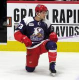 Matt Puempel of the Grand Rapids Griffins stretches during pre-game warmups before the team's annual Purple Game.