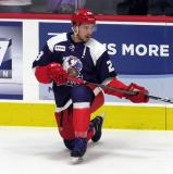 Dominic Turgeon of the Grand Rapids Griffins stretches during pre-game warmups before the team's annual Purple Game.