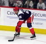 Eric Tangradi of the Grand Rapids Griffins gets set for a faceoff during the team's annual Purple Game.