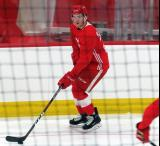 Michael Rasmussen skates with a puck during pre-game warmups before a scrimmage at the Detroit Red Wings' 2018 Development Camp.