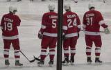 Steve Yzerman, Nicklas Lidstrom, Chris Chelios and Sergei Fedorov stand at the blue line after being introduced before the Pro-Am Skate for Mott game.