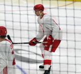 Alec Regula gets set for a faceoff during a scrimmage at the Detroit Red Wings' 2018 Development Camp.