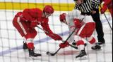 Michael Rasmussen of the red team takes a faceoff against Colt Conrad of the white team during a scrimmage at the Detroit Red Wings' 2018 Development Camp.