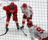 Givani Smith and Otto Kivenmaki line up on the wing for a faceoff, with Joe Veleno getting ready to take the draw, during a scrimmage at the Detroit Red Wings' 2018 Development Camp.