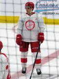 Alec Regula stands in the neutral zone during a stop in play in a scrimmage at the Detroit Red Wings' 2018 Development Camp.