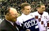 Scotty Bowman, Igor Larionov and Steve Yzerman pose for photos on the ice after Larionov's Farewell Game in Moscow.