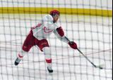 Dennis Cholowski passes the puck up ice during a scrimmage at the Detroit Red Wings' 2018 Development Camp.