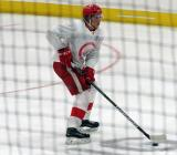 Dennis Cholowski skates with the puck during a scrimmage at the Detroit Red Wings' 2018 Development Camp.