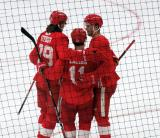 Malte Setkov, Filip Zadina, and Michael Rasmussen celebrate Zadina's scrimmage-winning goal at the Detroit Red Wings' 2018 Development Camp.