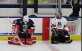 Jimmy Howard and Craig Anderson stretch in front of the benches during pre-game warmups before the 2018 Stars & Stripes Showdown.