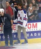 Jack Hughes stands on the ice, helping with a pre-game ceremony before the 2018 Stars & Stripes Showdown.